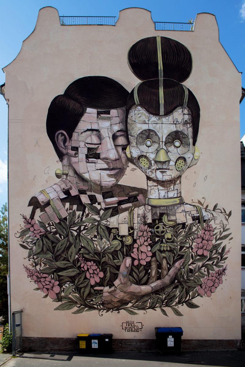 Halle ville allemande streetart pixel pancho mur figures - Désertée, la ville allemande de Halle reprend vie grâce au street art