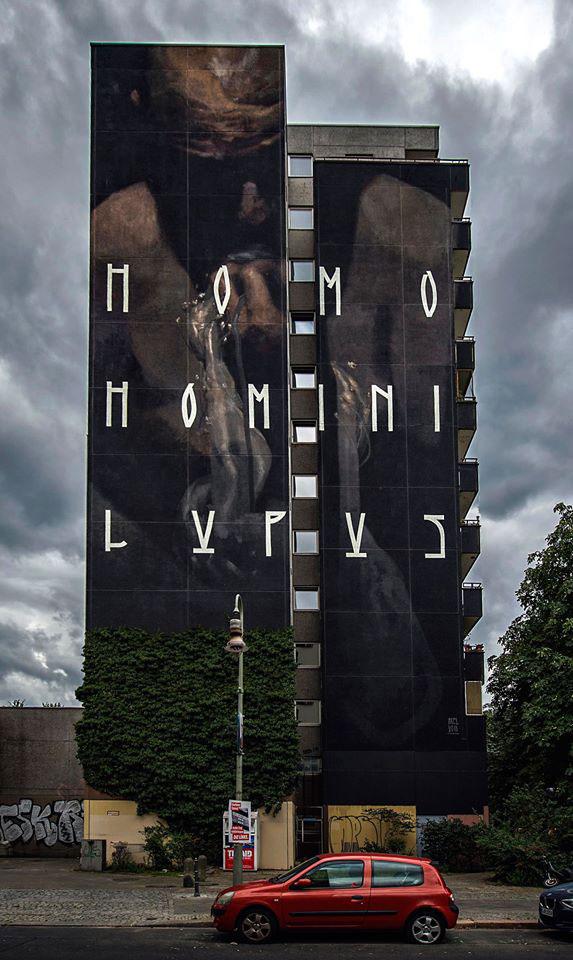 Axel Void street art peinture sombre vie habitant mono homini lupus immeuble noir homme vie fatalite - L'artiste Axel Void peint la noirceur et la beauté du quotidien sur les murs